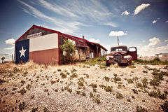 Abandoned restaraunt on route 66 road in USA. Abandoned restaraunt and old style car near gas station on the famous route 66 road in USA stock photo