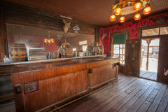 Abandoned restored saloon from the American Wild West. Restored saloon in an abandoned log building in a ghost town in Cody Wyoming near Yellowstone National royalty free stock photography