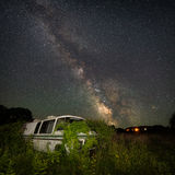 Abandoned retro camper van under the milky way galaxy Royalty Free Stock Images