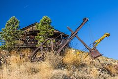 Abandoned Retro Crane & Buckets In Desert. Abandoned Retro Cranes & Buckets On Side Of Hill In Desert stock photography