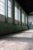Abandoned riding hall without horses and horsemen. Vertical shot of a sandy covering training arena for riders and horsemen Stock Photography