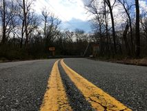 Abandoned Road. Leading to a bridge in Maryland, USA royalty free stock photo