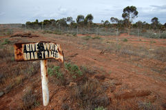 Abandoned road sign. Near closed road, Western Australia Stock Photos
