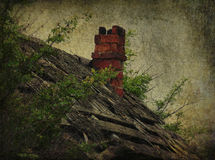 Abandoned roof with chimney Stock Photo