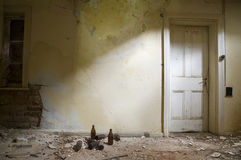 Abandoned Room with Door. Abandoned Room with a white door Royalty Free Stock Photography