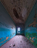 Abandoned room interior. Wide angle shot of abandoned room with one window Stock Photography