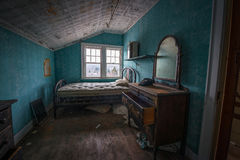 Abandoned Room with an old phone and dresser. Abandoned bedroom in Adler Hotel, New York Royalty Free Stock Photos
