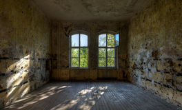 Abandoned Room. Old abandoned room with sunlight coming in through the windows Royalty Free Stock Images
