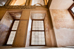 Abandoned room of Persian palace with historical fresco on the walls. Stock Photography