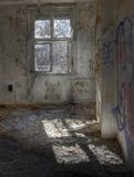 Abandoned room with a window Stock Photos