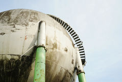 Abandoned round shape industrial gas tank Stock Photo