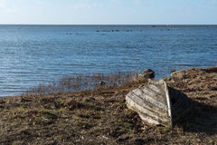 Abandoned rowboat by the coast Royalty Free Stock Photo