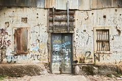 Abandoned ruined building, windows and door closed royalty free stock photos