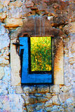Abandoned And Ruined House. With Blue Window Stock Photo