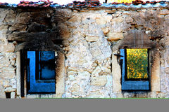 Abandoned And Ruined House. With Blue Window Royalty Free Stock Photos