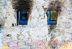 Abandoned And Ruined House. With Blue Windows Royalty Free Stock Photography