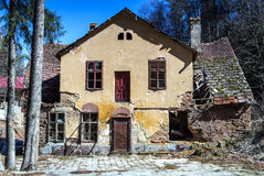 Abandoned house in daylight. Abandoned, ruined house in daylight against blue sky Stock Images