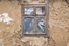 Abandoned ruined house. Empty window in abandoned ruined house Stock Photography