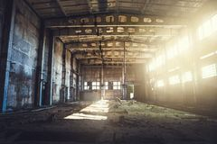 Abandoned ruined industrial factory building, corridor view with perspective, ruins and demolition concept. Toned Royalty Free Stock Images