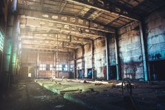 Abandoned ruined industrial factory building, corridor view with perspective, ruins and demolition concept. Toned Stock Image