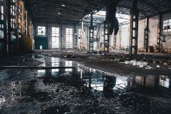 Abandoned ruined industrial factory building, ruins and demolition concept. Toned stock photography