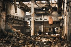 Free Abandoned Ruined Industrial Warehouse Or Factory Building Inside, Corridor View With Perspective, Ruins And Demolition Concept Stock Photo - 125159370