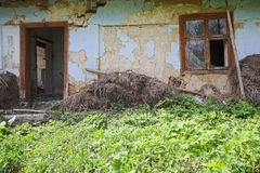 Abandoned ruined old house. Ruined and abandoned house in countryside Stock Photography
