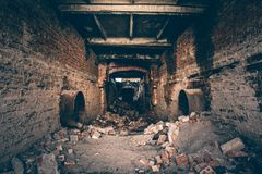 Abandoned ruins of industrial sewage tunnel, sewerage corridor view, perspective, ruins and demolition. Concept Royalty Free Stock Photos