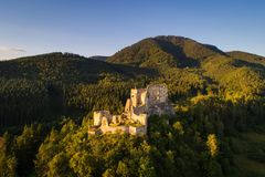 Abandoned ruins of a medieval castle in the forest. Abandoned ruins of a medieval castle in the golden evening light at sunset Stock Images