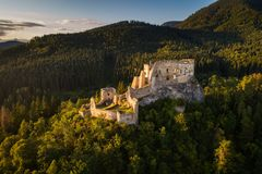 Abandoned ruins of a medieval castle in the forest. Abandoned ruins of a medieval castle in the golden evening light at sunset Royalty Free Stock Photography