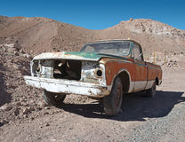 Abandoned rundown car. On the deserted road at hot sunny day Stock Photography