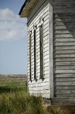 Abandoned Rural Church Side. Dilapidated and abandoned church against a dark blue cloudy sky Royalty Free Stock Photo