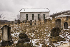 Abandoned Rural Church - Southwest Pennsylvania. A cloudy day at the abandoned and historic Enon Church near Greysville, Pennsylvania. The church cemetery is in Stock Image