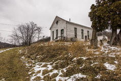 Abandoned Rural Church - Southwest Pennsylvania. A cloudy day at the abandoned and historic Enon Church near Greysville, Pennsylvania. The church cemetery is in Stock Photos