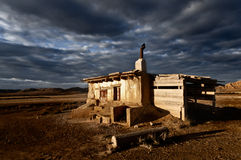 Abandoned rural house landscape dramatic cloud sky Stock Photo