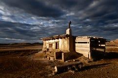 Abandoned rural house landscape dramatic cloud sky. Abandoned house landscape dramatic cloud sky b Stock Photo