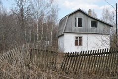 Abandoned rural house with rickety fence Royalty Free Stock Images