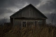 Abandoned rural house in Russian village. Gloomy scene royalty free stock images