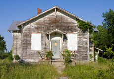 Abandoned Rural One Room Schoolhouse. An abandoned one-room rural school house located in Kansas, United States.  Front view of the old school building showing Royalty Free Stock Images
