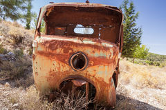 Abandoned rusted body of commercial vehicle. Abandoned rusted body of three-wheeled light commercial vehicle royalty free stock photography