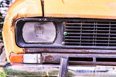 Abandoned rusted car closeup royalty free stock photography