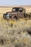 Abandoned rusted 1940s era Chevrolet farm truck in field, Easter stock images
