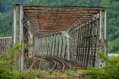 Abandoned rustic train bridge over river Royalty Free Stock Photography