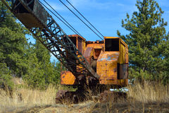 Abandoned Rusting Antique Orange and Black Crane Royalty Free Stock Photo