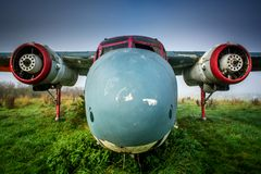 Abandoned rusty aircraft nose and with missing propellers. Royalty Free Stock Images