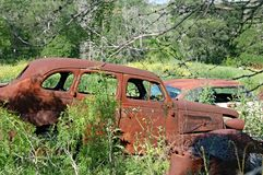 Abandoned Rusty Car. In field royalty free stock photo