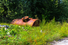 Abandoned rusty container for combustible materials. Royalty Free Stock Photo