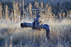 Abandoned rusty irrigation pipe to nowhere against tall grass in the Cradleboard Trail walking path on the Carolyn Holmberg Preser. Ve in Broomfield Colorado by royalty free stock images