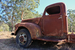 Abandoned rusty pickup truck. Abandoned old rusty pickup truck in field Royalty Free Stock Photography