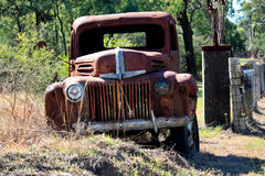 Abandoned Rusty Pickup truck. An old abandoned rusty pick up truck along the fenceline on rural property Stock Images